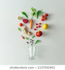 Creative food layout with fruits, vegetables and leaves on bright marble table background with tea c...