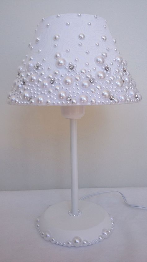 Photo of Fabric-coated dome lamp with pearls and stras.