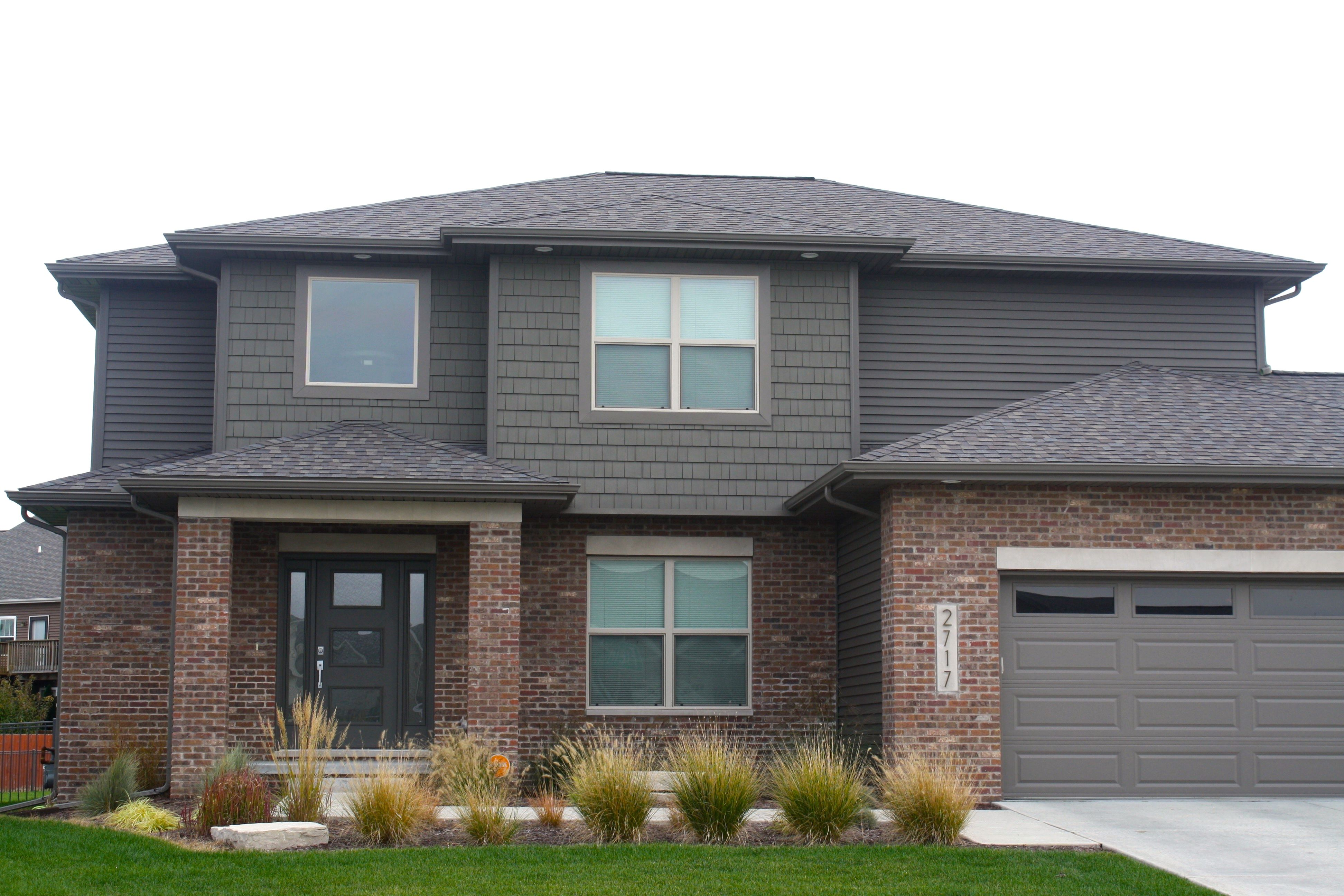 image result for brown brick with dark siding house exterior