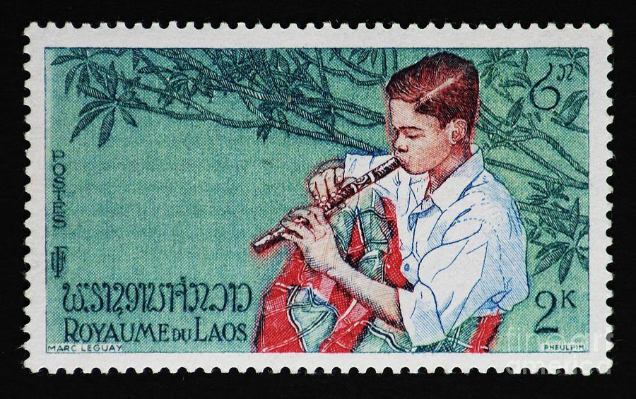 boy playing flute vintage postage stamp