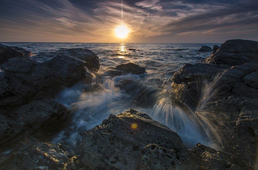 Waves washing over the rocks at Marino Rocks in South Australia