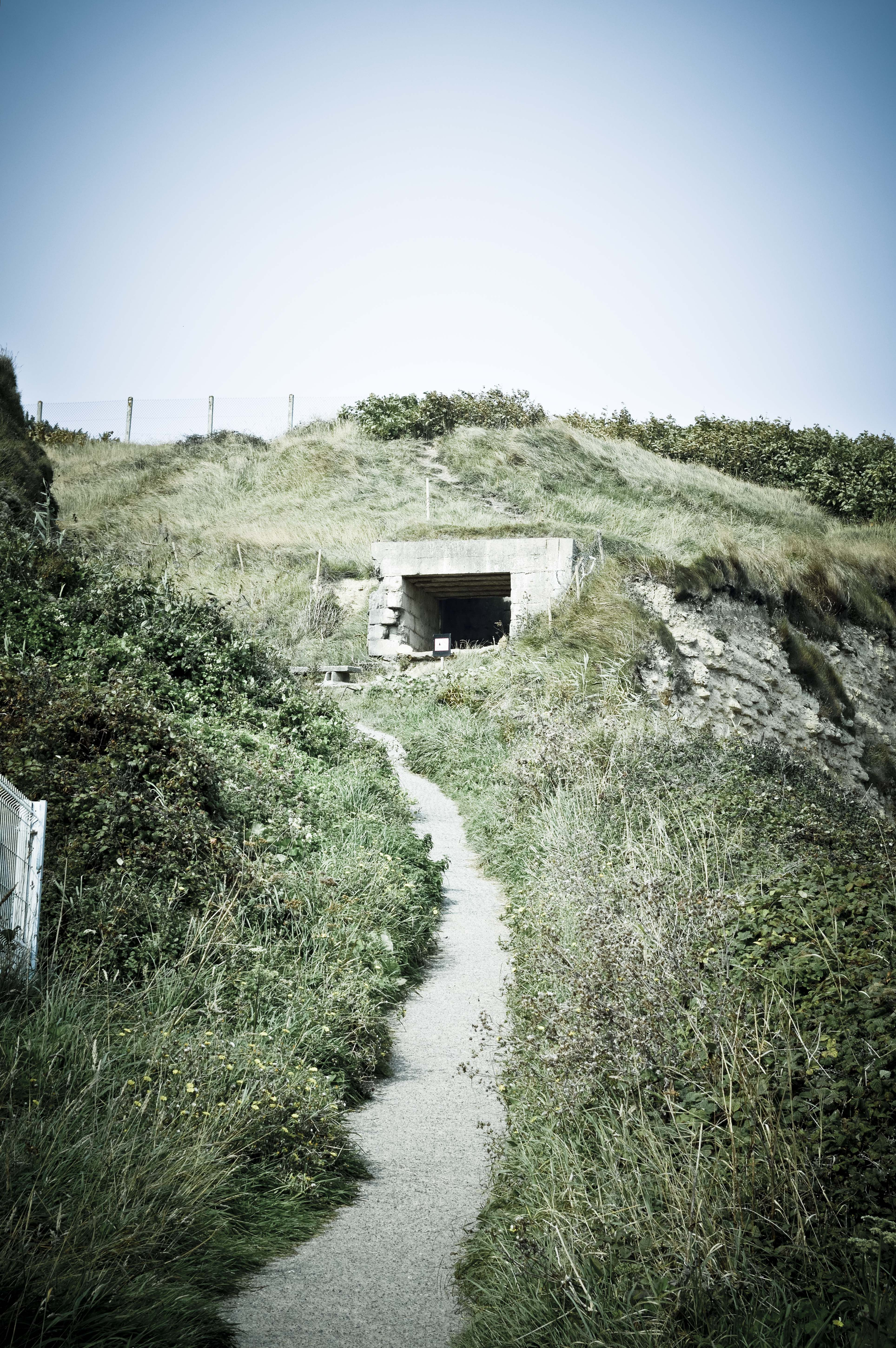 Omaha Beach MG position, Dog green sector. This gun position over looks the artillery on the beach, the main exit or draw, and this main path up into the bluffs