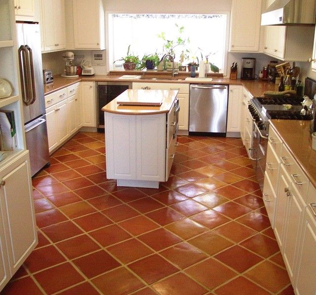 Traditional Saltillo Terra Cotta Floor Tile In A Beautiful White Kitchen