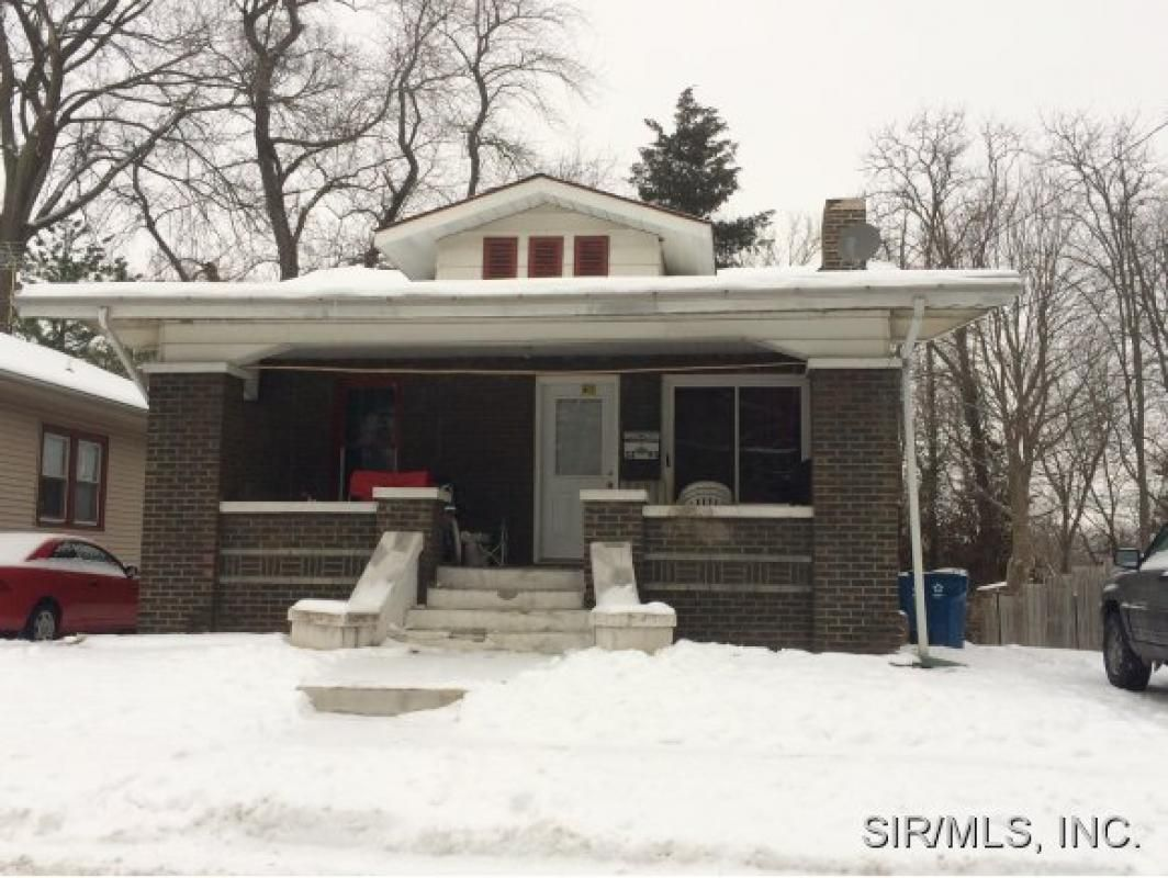 Brick Bungalow Features Fireplace Full Walk Out Basement Large Yard 6x22 Covered Front PorchesRental