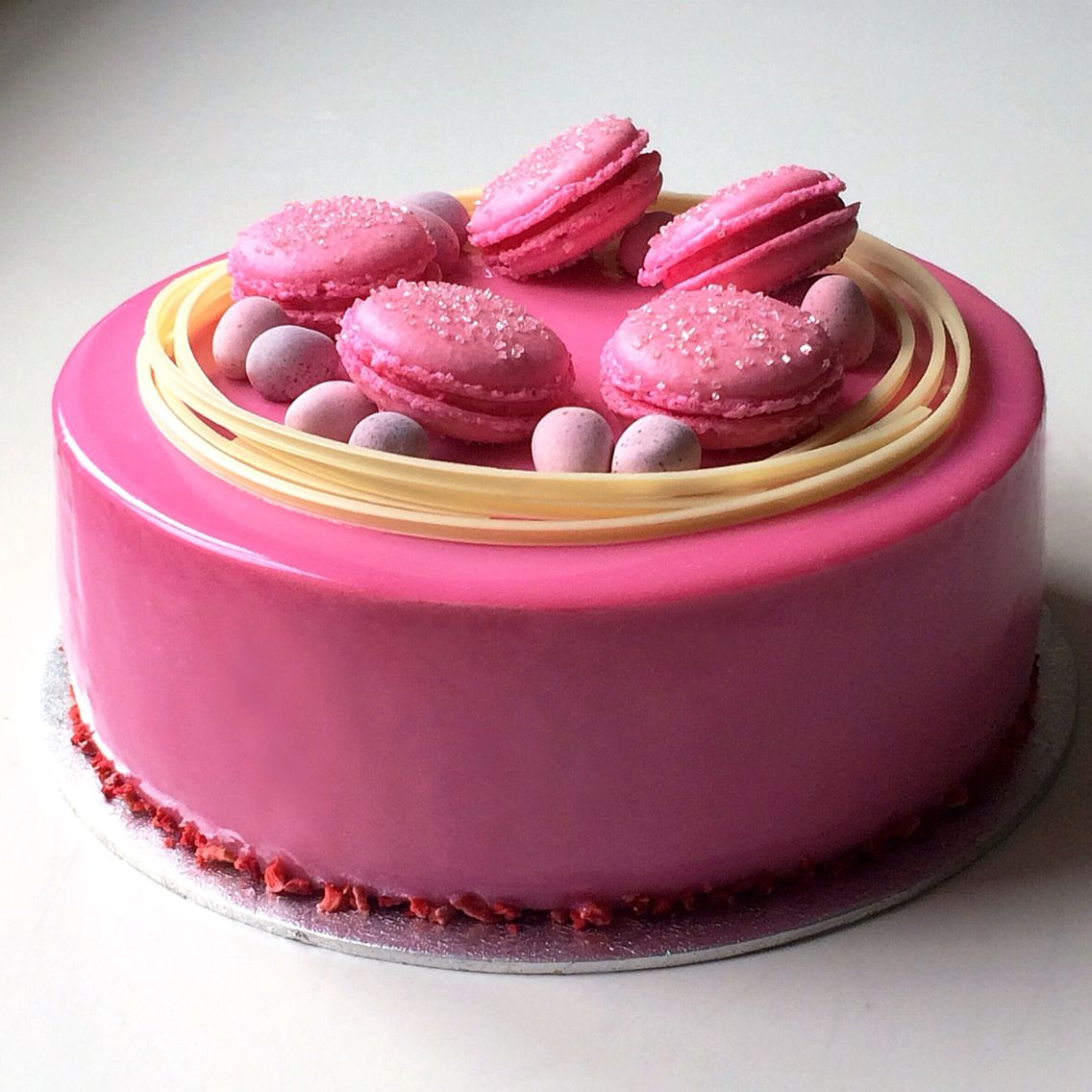 Chocolate sponge cake with raspberry mousse and pink ...