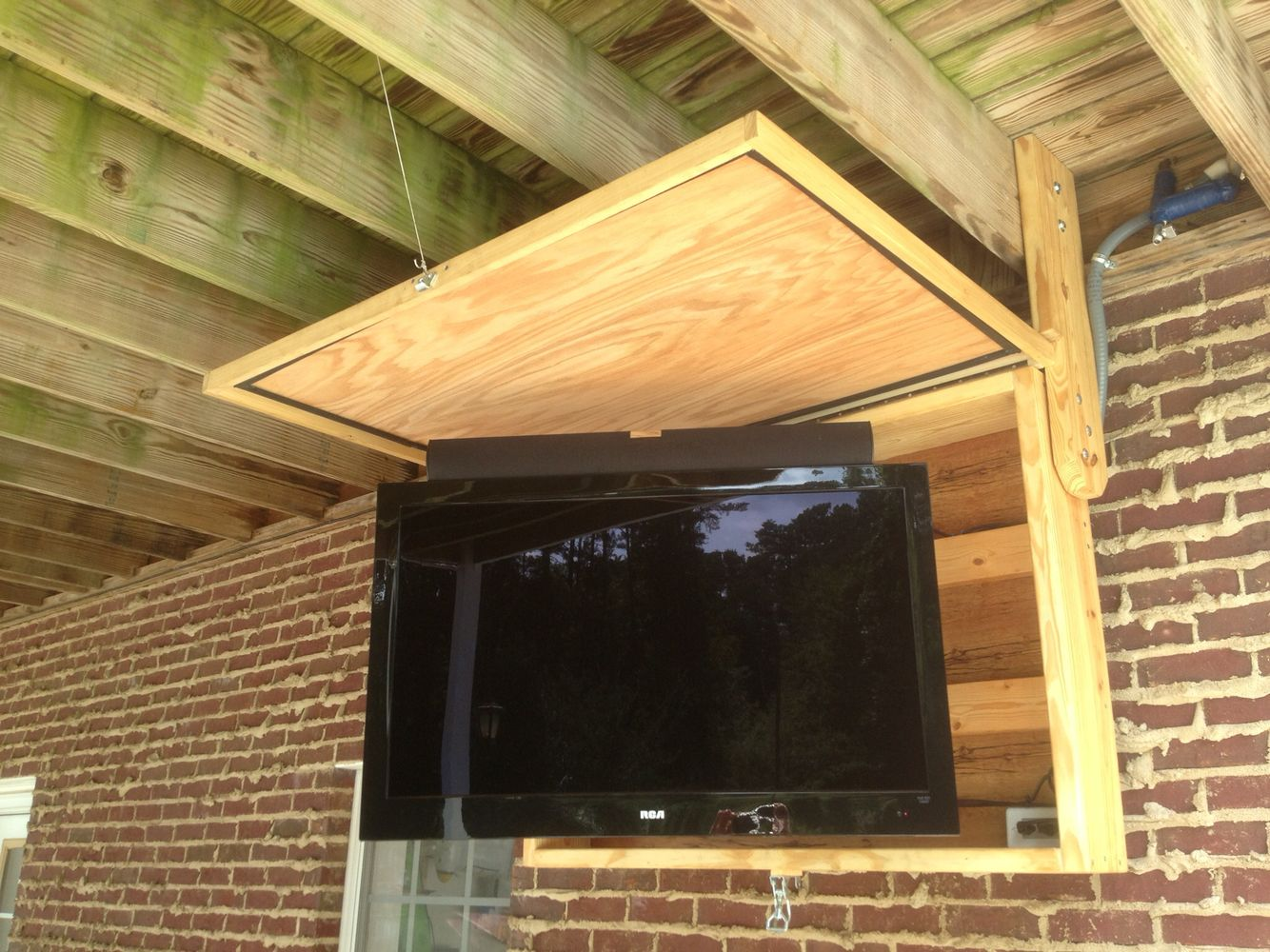 Perfect Outdoor Tv Cabinet. Swivel Tv And Mounted Sound Bar.