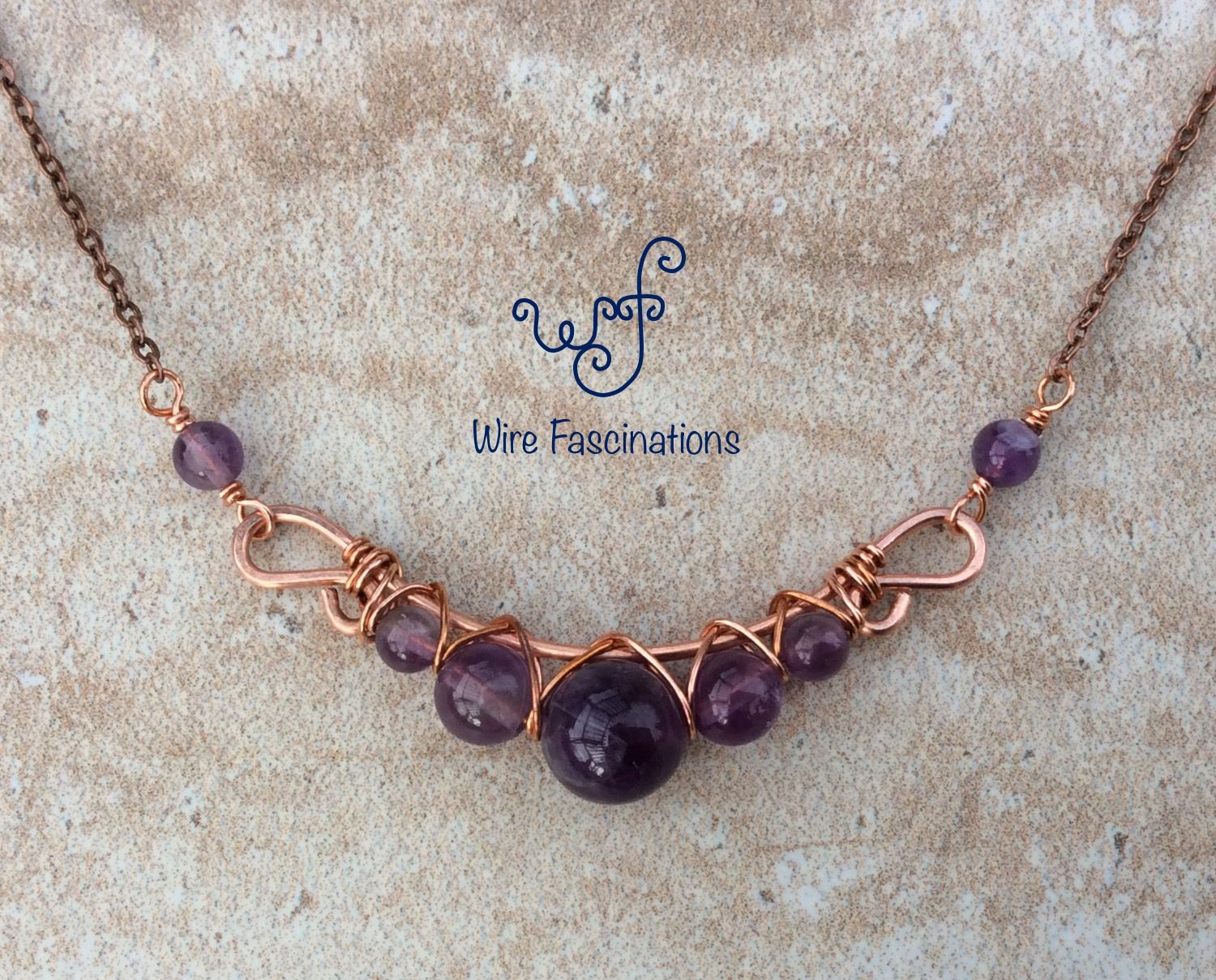Photo of Handmade amethyst necklace: criss cross copper wire wrapped