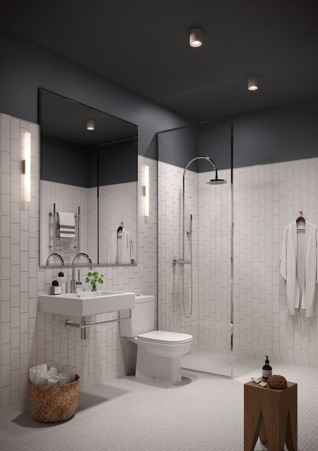 A perfect example of where a darker ceiling adds a cozier feeling to this all white bathroom!