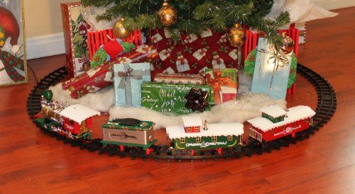 christmas train sets going around the tree delightful family decoration
