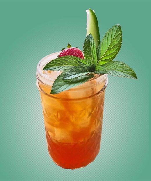 Copa di Sangue: Solerno Blood Orange Liqueur, Pimm's No. 1, Meyer Lemon Juice, Strawberries, Fever Tree Bitter Lemon Soda Cucumber Spear, Sprig of Mint.
