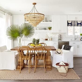 Beige Beaded Chandelier Over Small Reclaimed Wood Dining Table