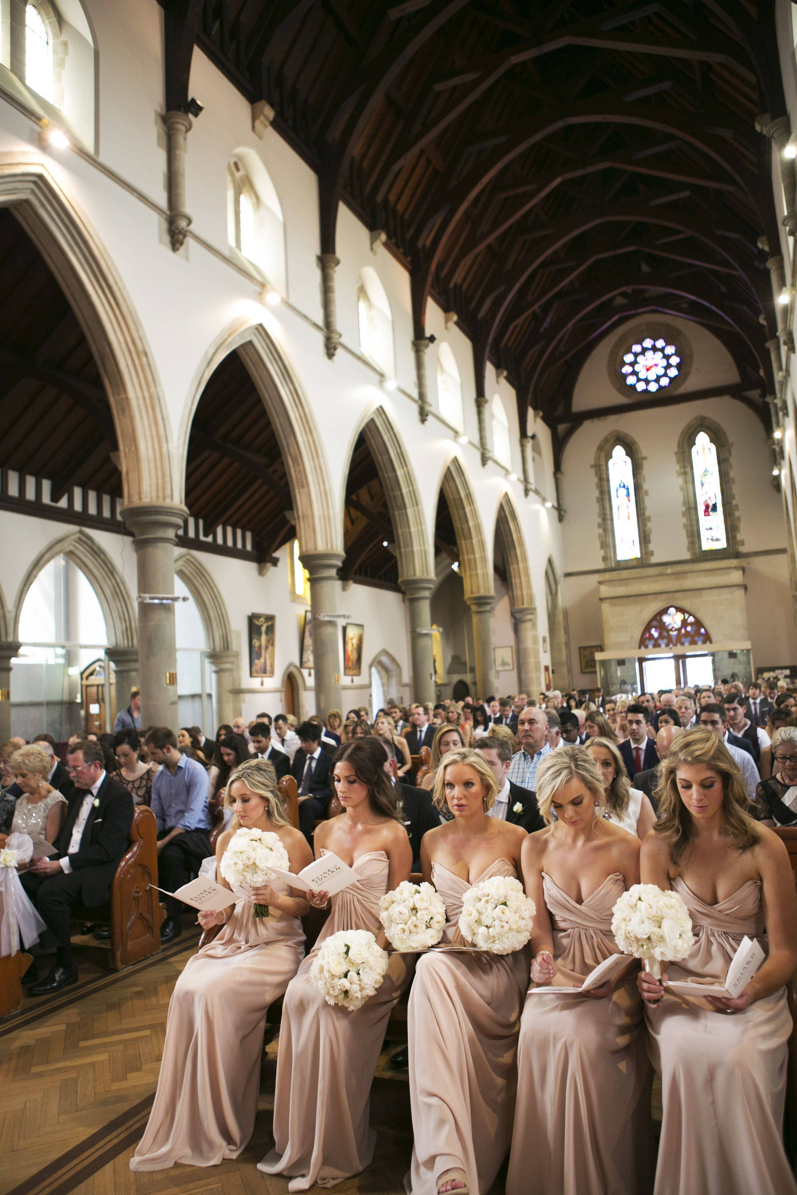 Church wedding ceremony, love those bridesmaids in neutral | itakeyou.co.uk