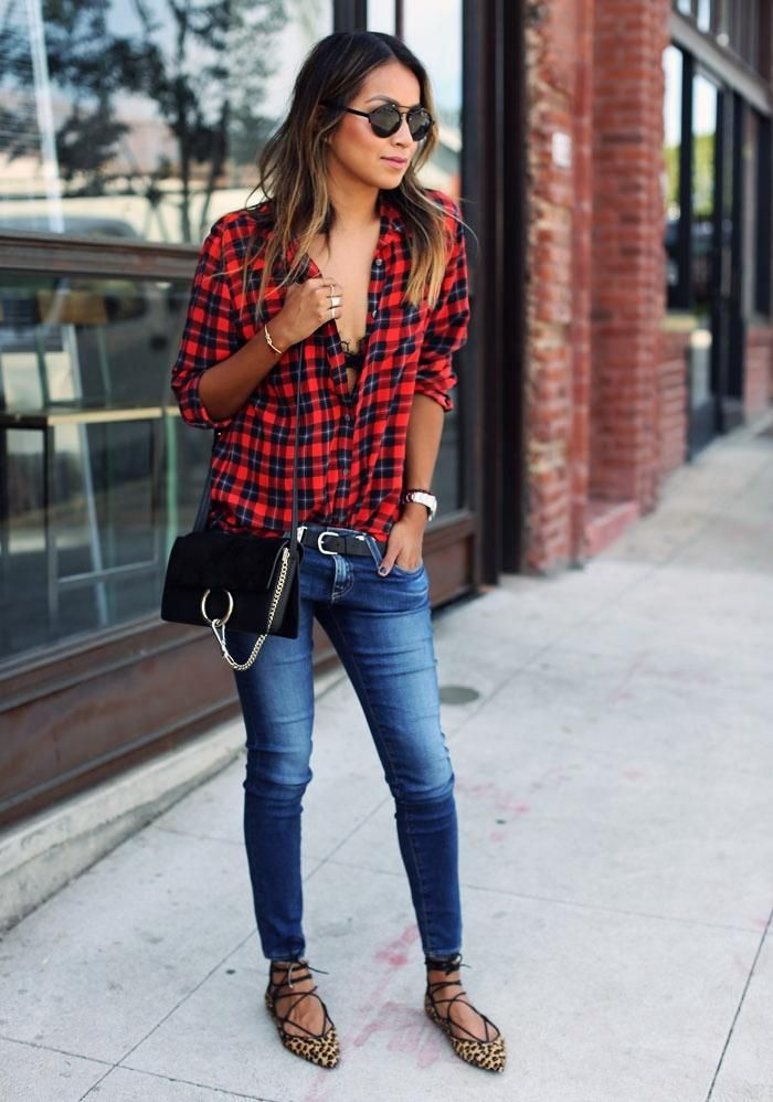5f33db441 50 Jeans Outfits to Copy This Fall - Blogger Sincerely Jules wearing skinny  jeans with a plaid shirt and gladiator sandals