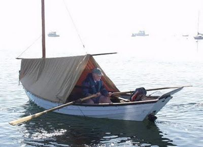 Suspended from the sprit of a lug rigged Swampscott Dory | Boom Tents and Dinghy Cruising in ...