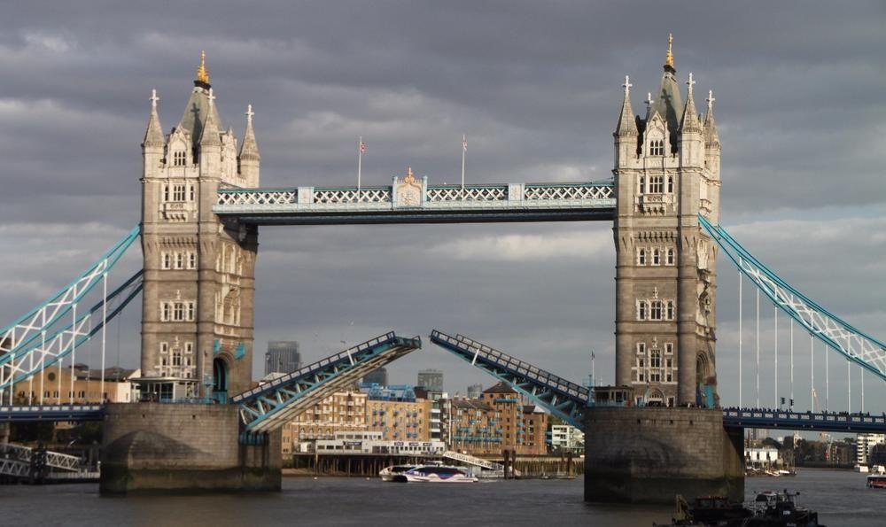 Tower Bridge Opening To Let Ship Pass London Tower Bridge Free Travel Bike Trips