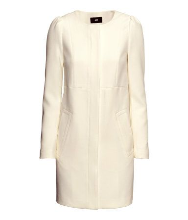 Fitted coat in slightly textured woven fabric. Puff sleeves ...