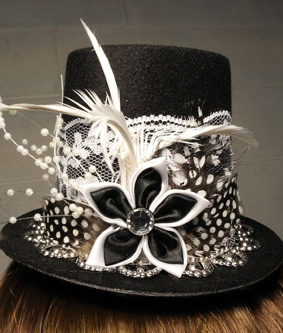 a743eb2cd01 Black Mini Top Hat with Black and White Ribbon Flower Centerpiece ...