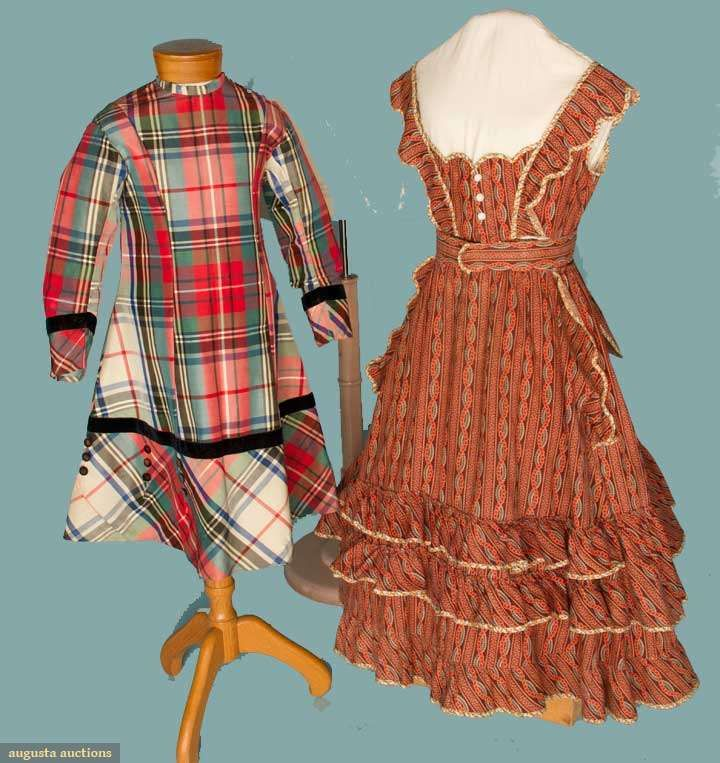 """1 1860s 3-piece cotton, red, maroon vertical print: 1 dress w/ pinafore style top & faux apron, 1 long sleeve bodice w/ full sleeves & 1 belt w/ attached bow, CH 28"""", W 22"""", L 38""""; 1 1870s silk plaid, black velvet trim & buttons, CH 24"""", L 28.5"""", excellent. Augusta Auctions 2012"""