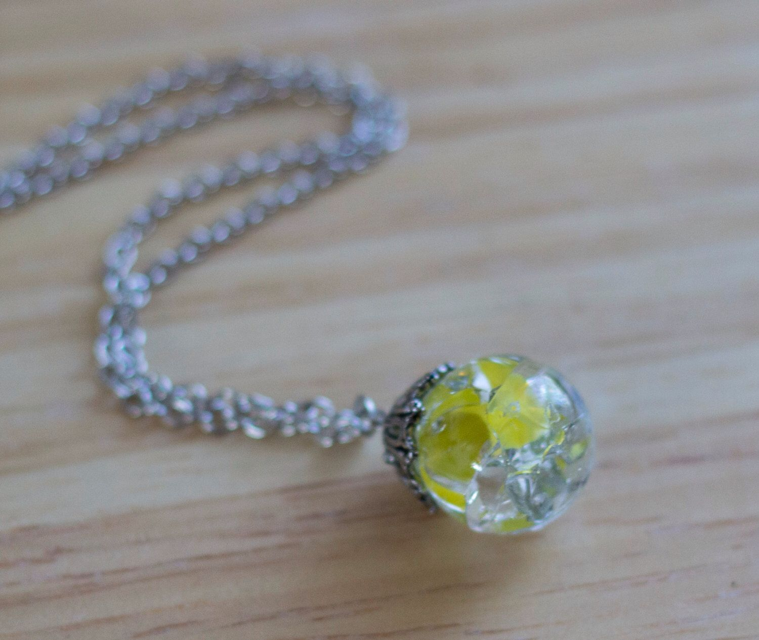 A personal favorite from my Etsy shop https://www.etsy.com/listing/241245930/yellow-baked-marble-necklace-cracked