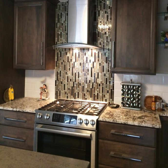 Brown Mosaic Backsplash | ProSource Wholesale A Vertical Tile Backsplash  Draws The Eye Upward And Creates Movement In This Contemporary Kitchen  Remodel.