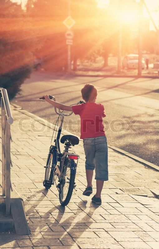 Little Boy With His Bike In A Street Backlit Young Boy Riding
