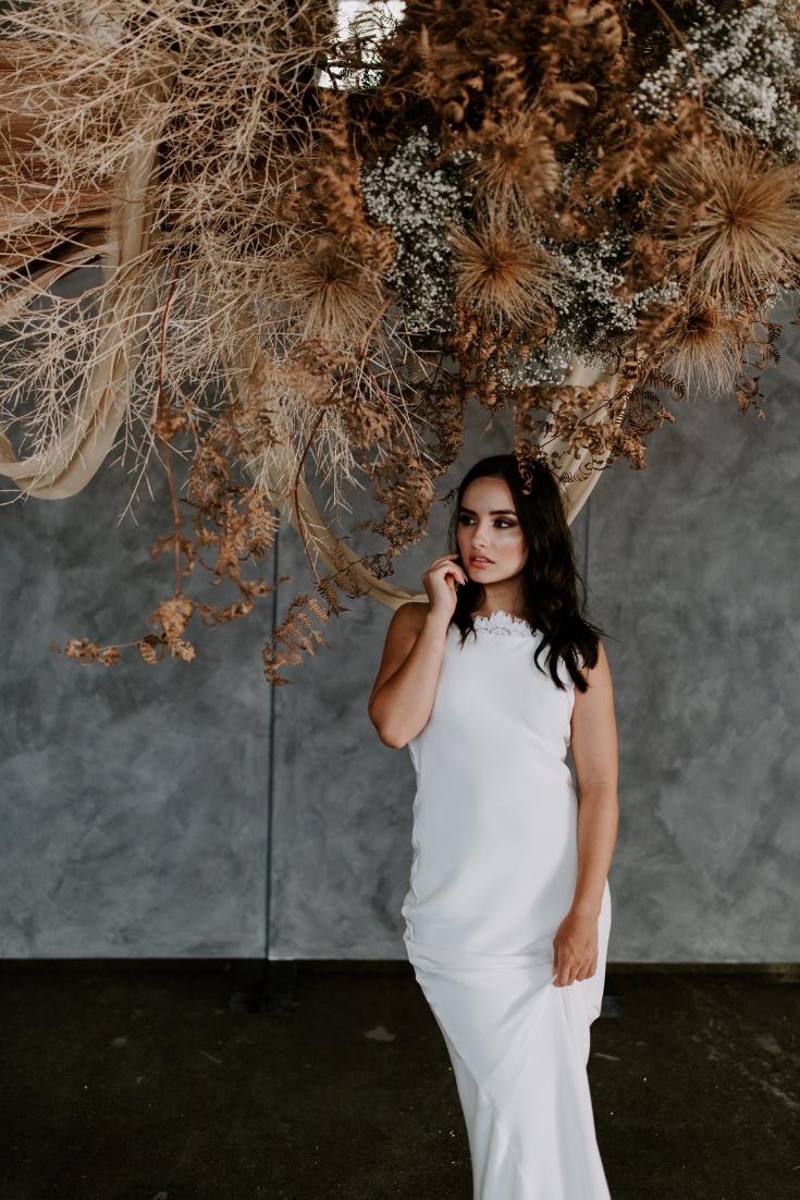 Wedding dress inspo and textured ceremony backdrop