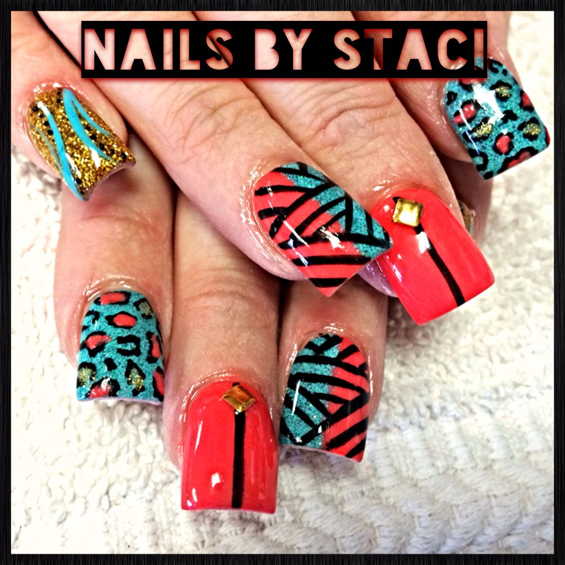 Gorgeous coral and teal nails