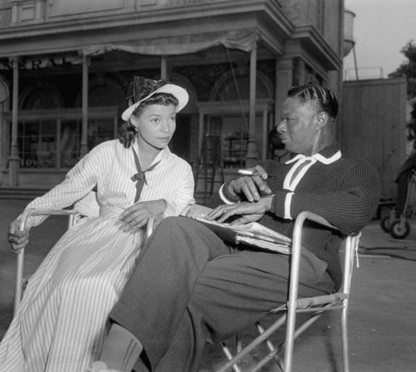 """Nat """"King"""" Cole and Ruby Dee relax on the set of """"St. Louis Blues"""" at Paramount Pictures in Hollywood on Oct. 28, 1957."""
