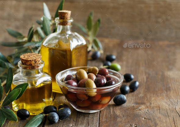 Olive Oil And Olives On Wood Background Extra Virgin Olive Oil Recipes Olive Oil Good For Skin Olive Oil Benefits