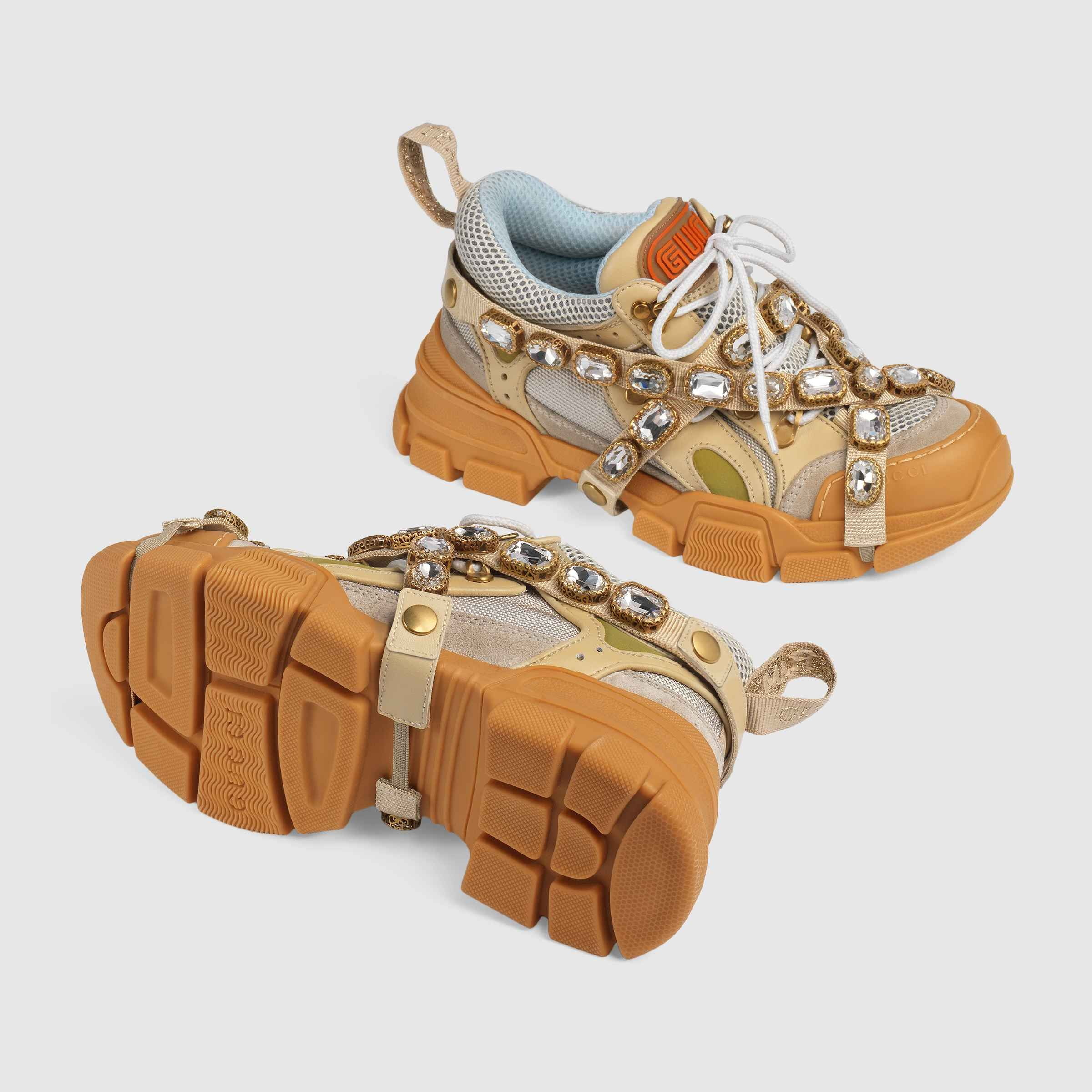 7cc2d2590db74 Shop the Flashtrek sneaker with removable crystals by Gucci. Sparkling  crystals are embroidered onto a removable elastic strap, wrapping around  these ...