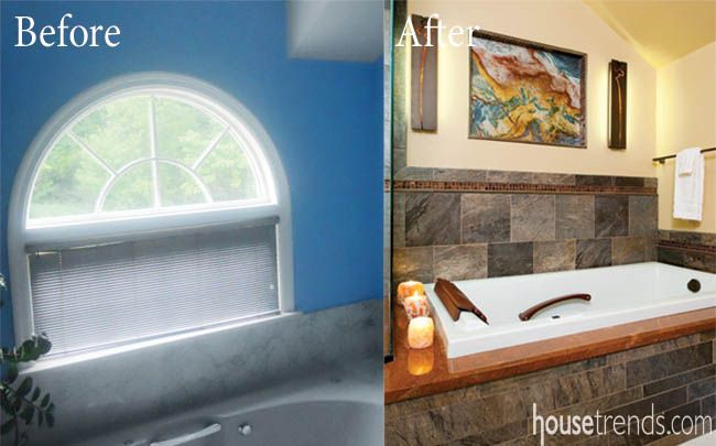 Bronze mosaic tile gives a bathtub an elegant edge that a blue painted wall couldn't. #housetrends @splashshowroom