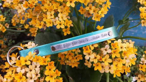 Don't follow your dreams, chase them.  Custom hand stamped leather wristlet by MyBella