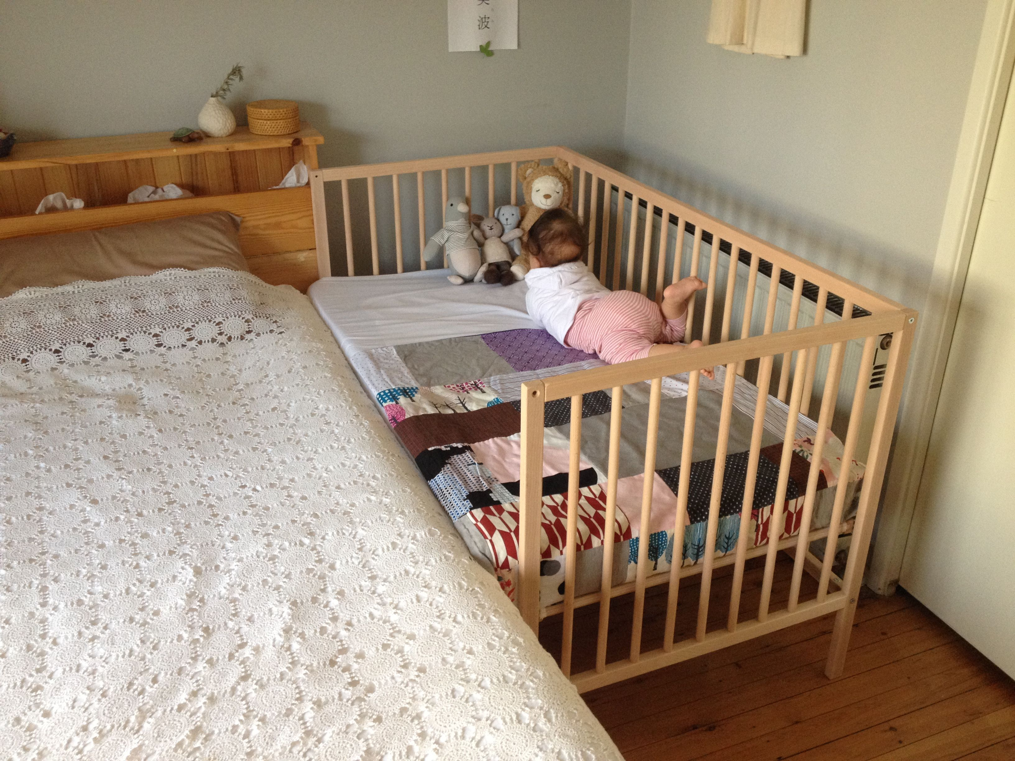 Baby bed with parents - A Co Sleeper Is A Baby Bed That Attaches To One Side Of An Adult Bed It Allows Baby To Remain Close To The Parents At Night Without Actually Being In The