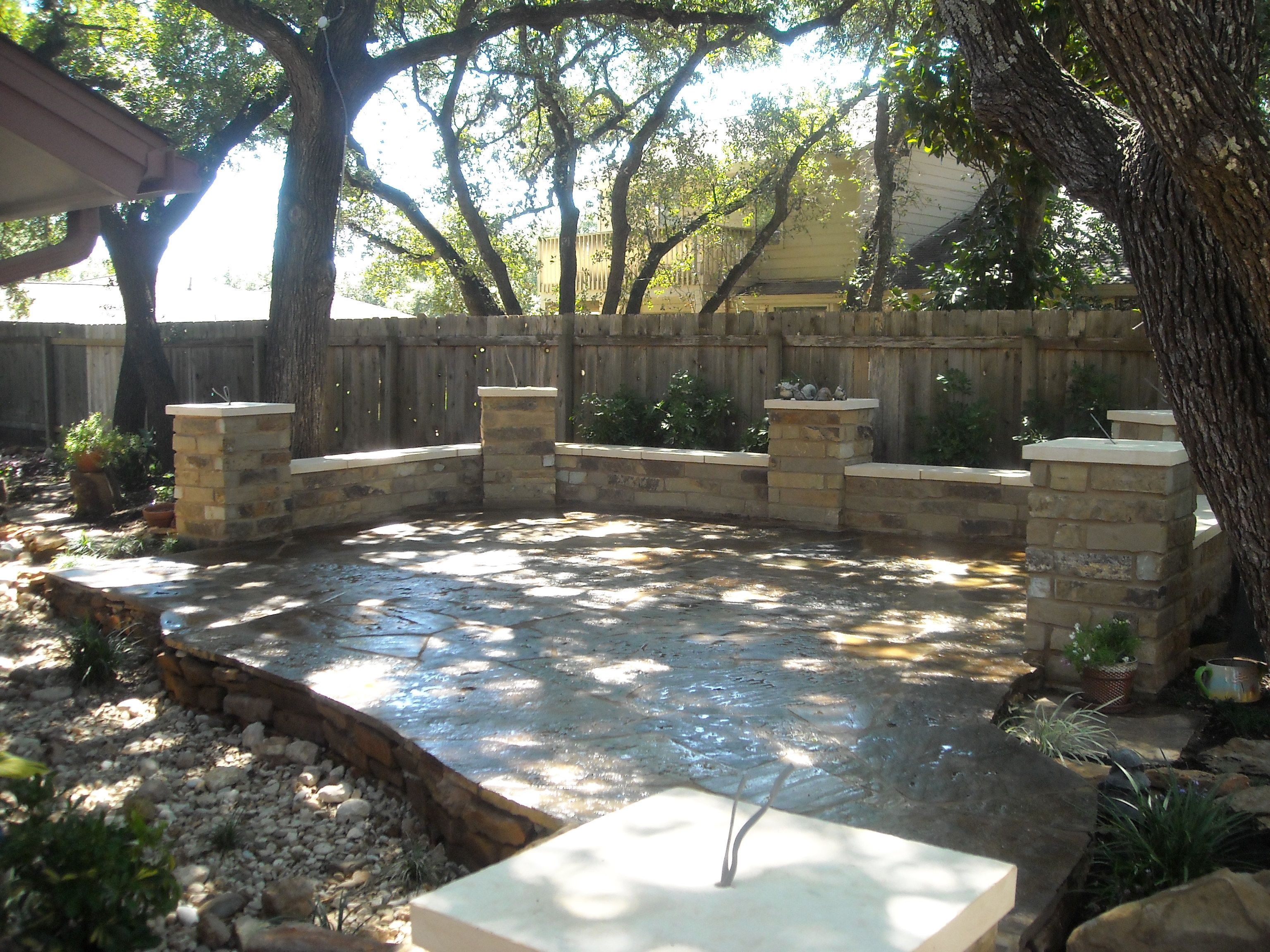 Flagstone patio with columns with a dry creek bed running Flagstone patios colleyville tx