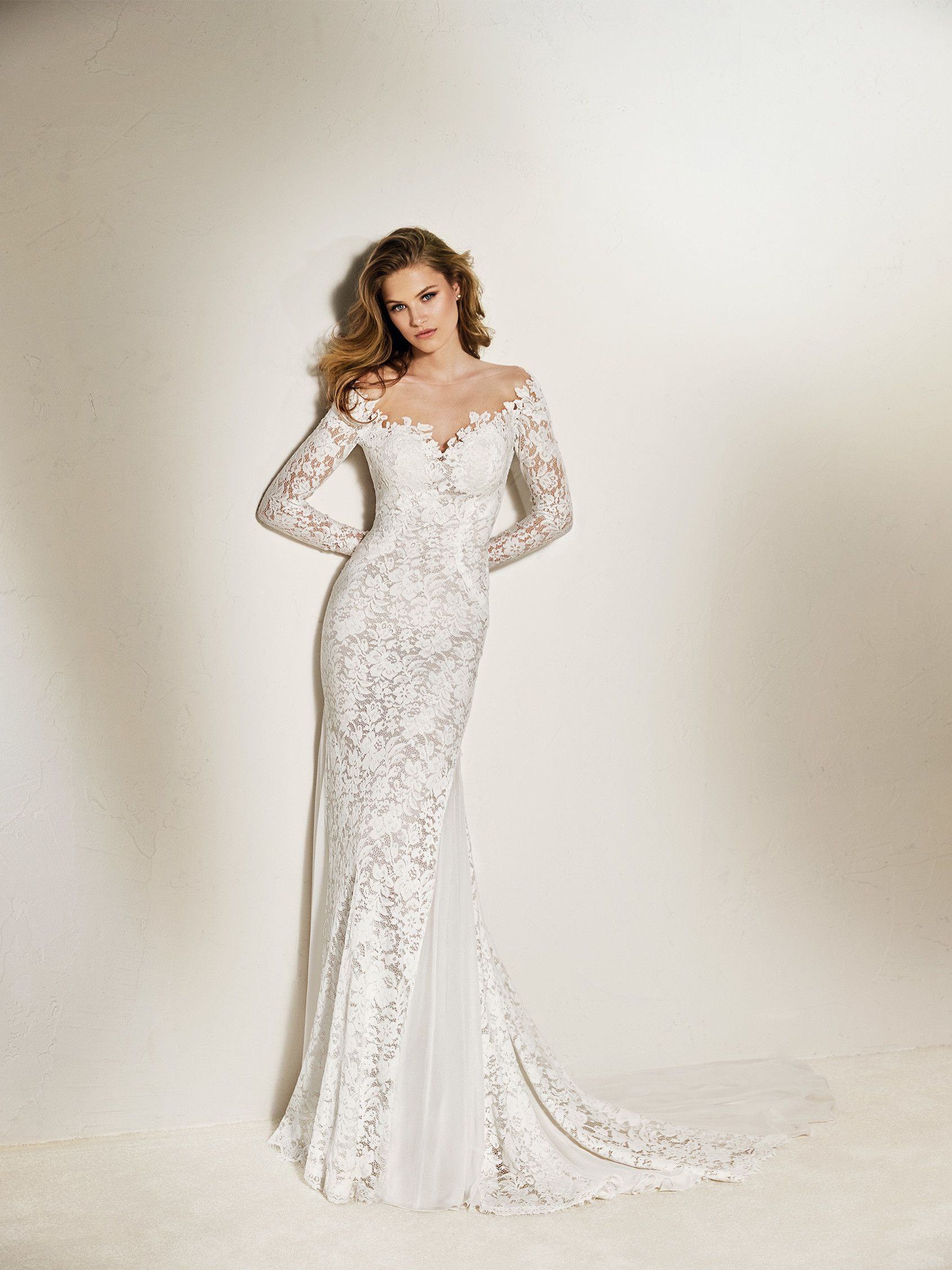 CHANDA  Long-sleeve mermaid wedding dress in lace and tulle with chiffon  panels. The fabric of this design creates a tattoo effect. aff2850d574