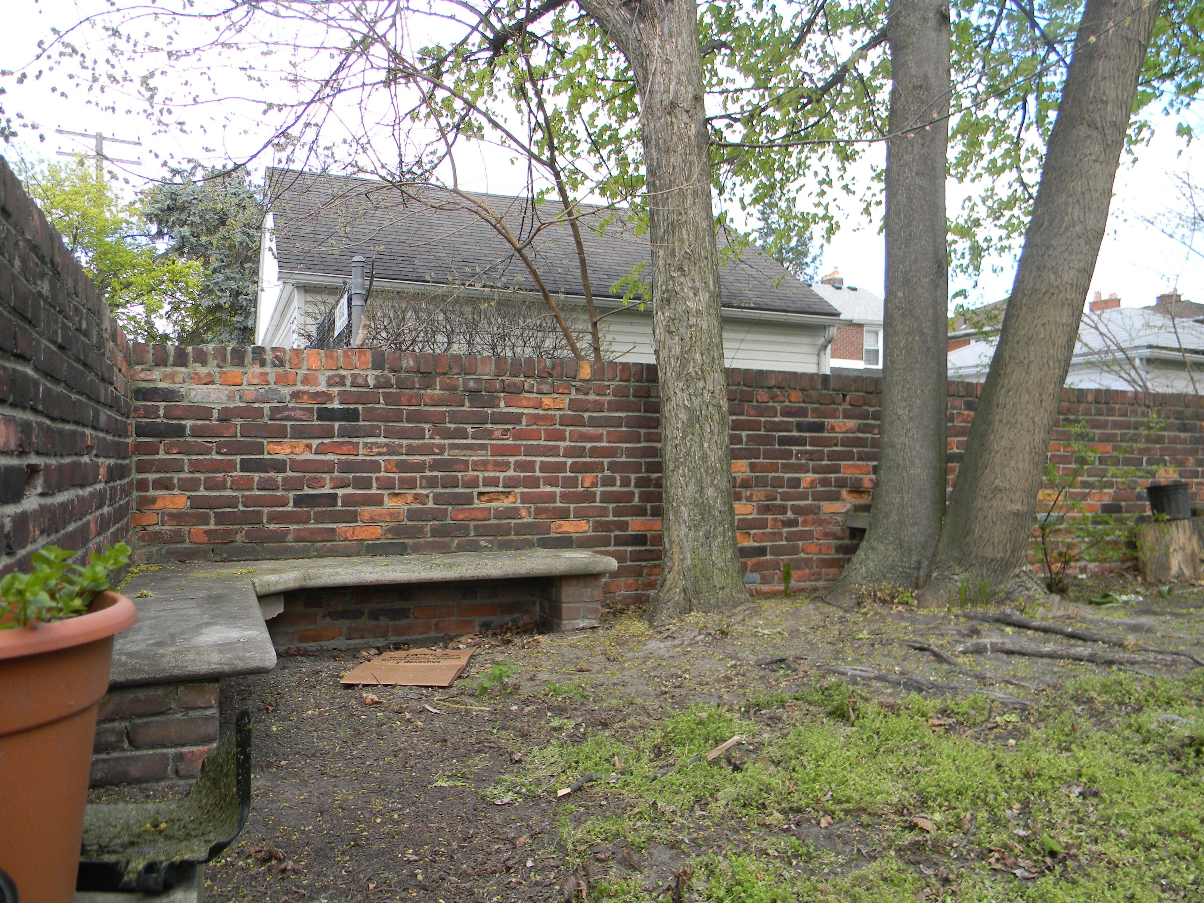 benches and shelves for pots were built into the backyard garden