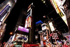 Times Square at night. - stock photo