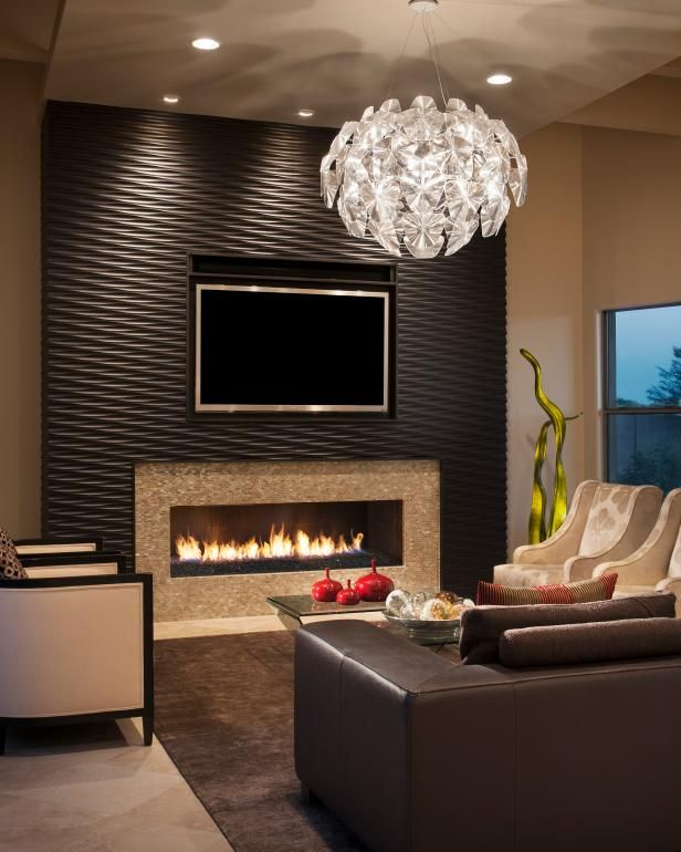 Living Room With Wood Clad Accent Wall Fireplace And Modern Chandelier Accent Walls In Living Room Living Room Tiles Wall Tiles Living Room