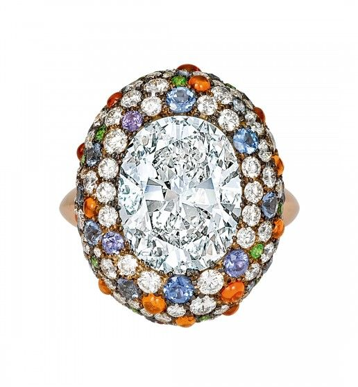 Ricci Ring – Centering an oval-cut diamond weighing 6.03 carats, bordered by pave set diamonds, garnets and sapphires. Mounted in 18k rose and 18k white gold.