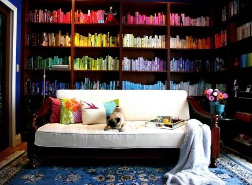 i'm debating whether or not to arrange my books by color. not sure my OCD will permit it, but it sure looks cool!