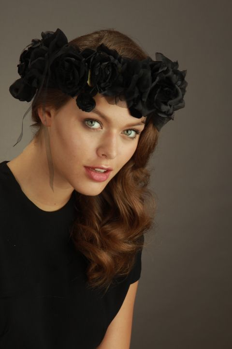 Wood Nymph in black silk roses, silk chiffon ribbon, and velvet and satin pods to highlight the face.