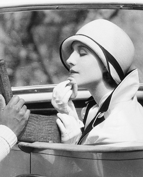 Norma Shearer touching up her makeup on the set of The Last of Mrs. Cheney, 1929