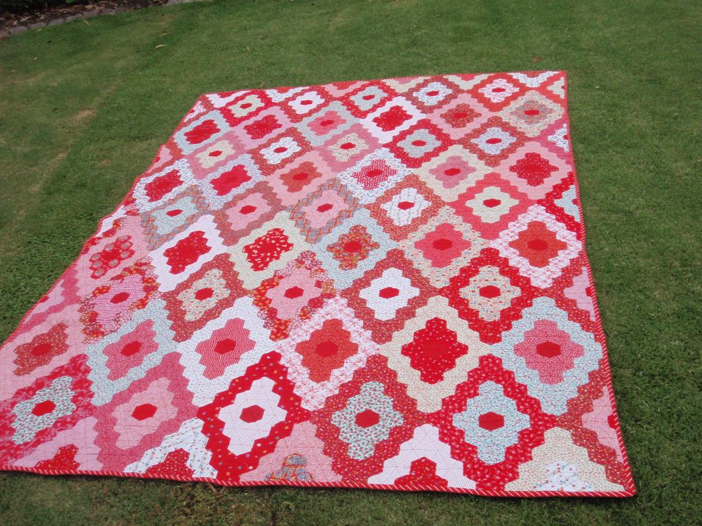https://flic.kr/p/9aSdZC | Diamond Hexagon quilt | finally finished after 30 years or more. Machine quilted , bound in a bias stripe. Many of the fabrics were scraps left after sewing for my 3 daughter's and the daughters of friends. THe girls have had fun recognizing and remembering their dresses