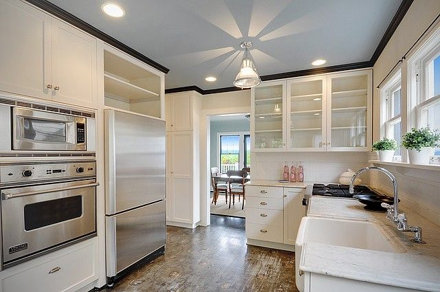 white kitchen with a twist....floors! black crown and grey ...