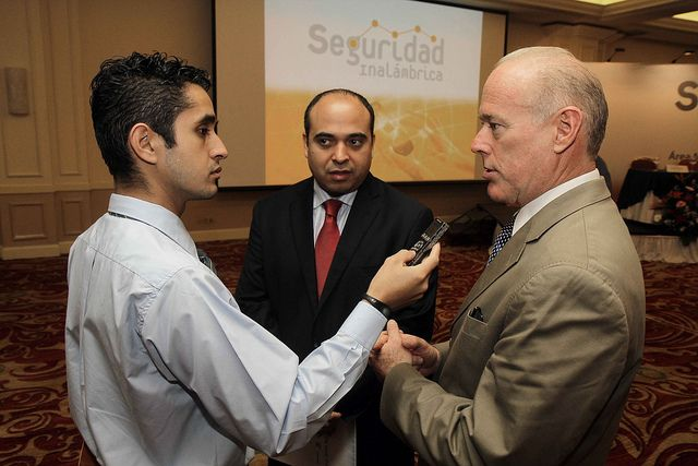 Aldo Miranda, RTI Central Regional Office Director, is interviewed about the Seguridad Inalámbrica mobile crime reporting system at the SI2 Launch event in El Salvador.     windows mobile security
