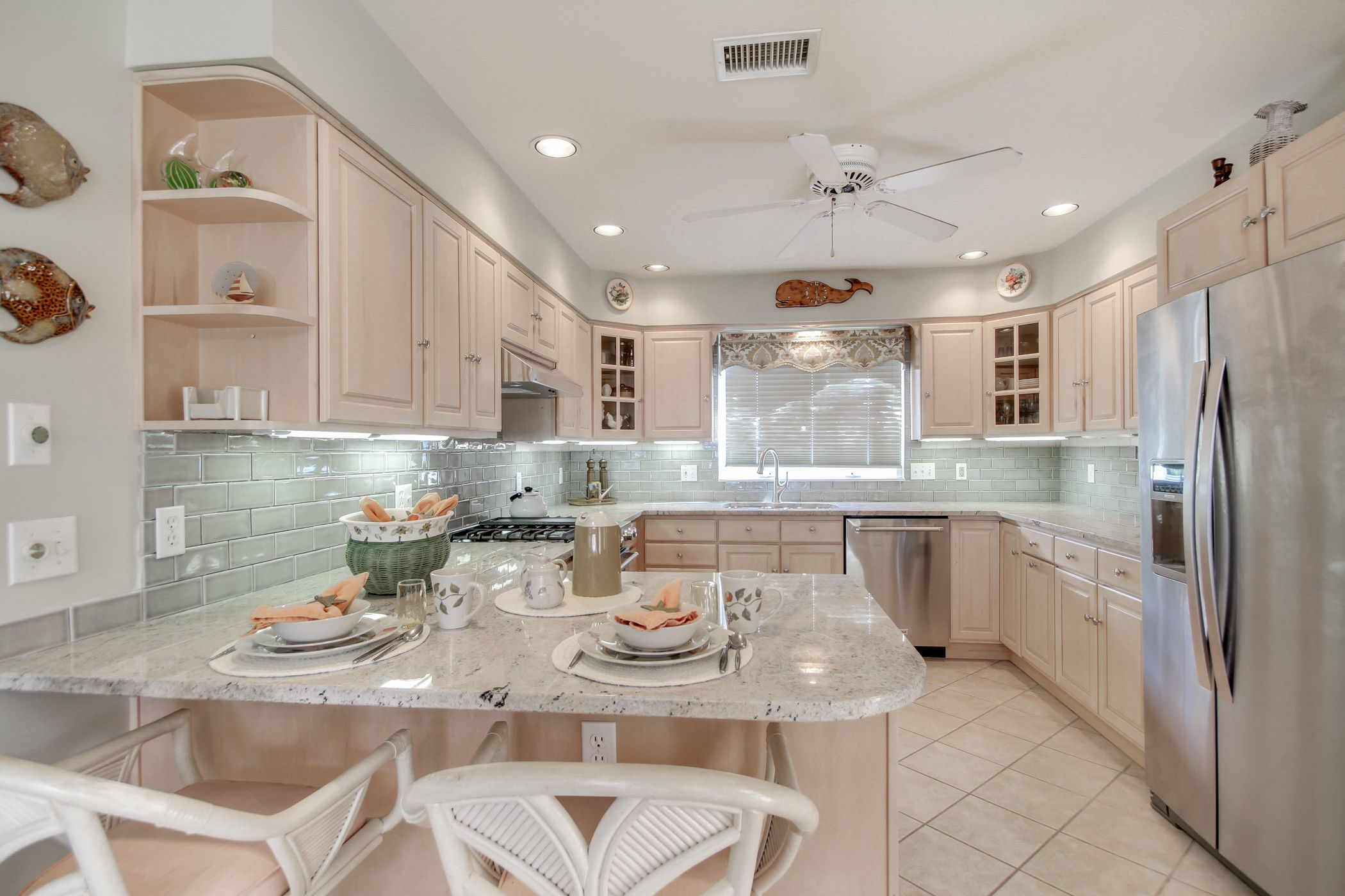 Beach House Kitchen With Crema Astoria Granite Countertops And A