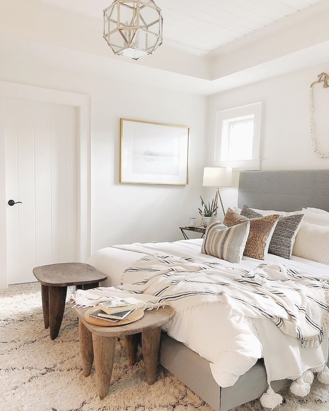 Accented Neutral Color Scheme Bedroom: Cloth&Main Gray Cloth Headboard, White Bedding, Neutral