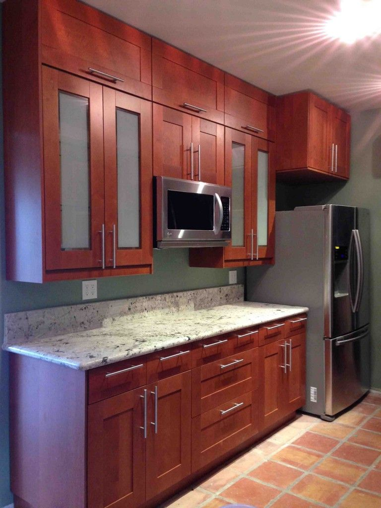 Beautiful Grimslov Medium Brown IKEA kitchen cabinets accented with a white  granite countertop. Beautiful Grimslov Medium Brown IKEA kitchen cabinets accented