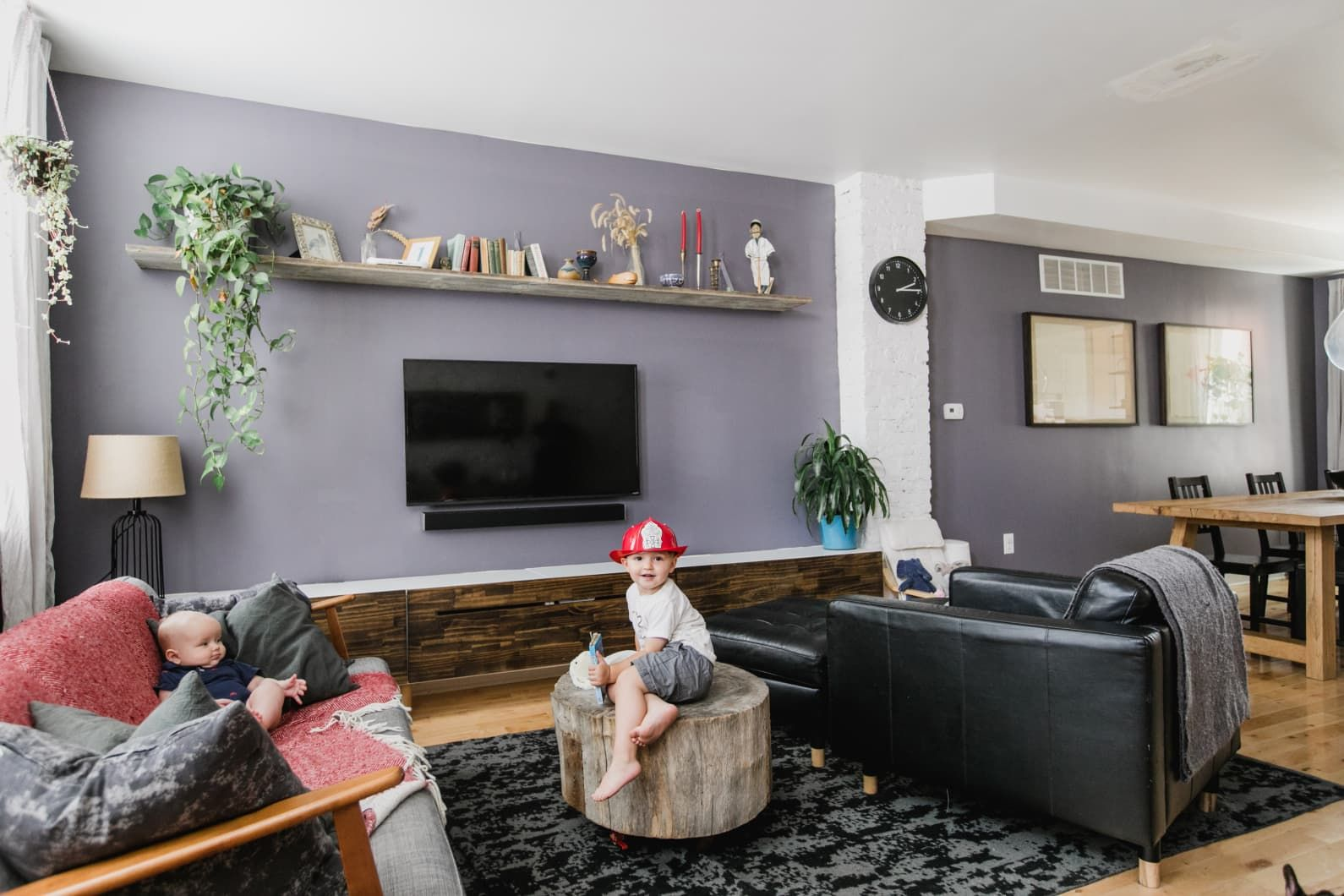 First Time Home Buyers Renovate A Philly Row Home On A Budget Purple Walls Living Room Purple Living Room Living Room Colors