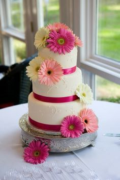 My wedding cake...only with red ribbon and red and white daisies. Love it!